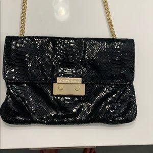Michael Korda black snake skin purse